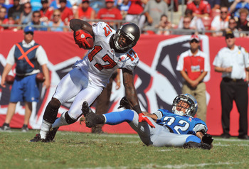 TAMPA, FL - SEPTEMBER 11:  Wide receiver Arrelious Benn #17 of the Tampa Bay Buccaneers rushes upfield with a pass against the Detroit Lions during the season opener September 11, 2011 at Raymond James Stadium in Tampa, Florida. (Photo by Al Messerschmidt