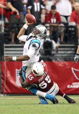 GLENDALE, AZ - SEPTEMBER 11:  Quarterback Cam Newton #1 of the Carolina Panthers throws the football away as he is tackled by Joey Porter #55 of the Arizona Cardinals during the NFL season opening game at the University of Phoenix Stadium on September 11,