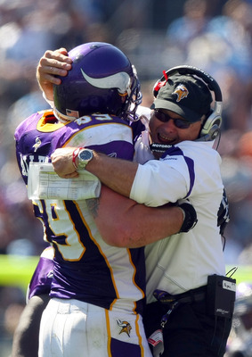 SAN DIEGO, CA - SEPTEMBER 11:  Jared Allen #69 of the Minnesota Vikings is congratulated by Defensive Coordinator Fred Pagac after Allen's interception during their season-opening Game against the San Diego Chargers on September 11, 2011 at Qualcomm Stadi