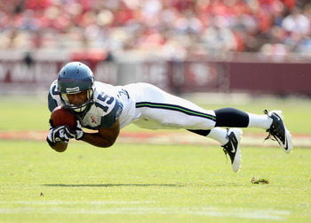 SAN FRANCISCO, CA - SEPTEMBER 11:  Doug Baldwin #15 of the Seattle Seahawks makes a diving catch during their season opener against the San Francisco 49ers at Candlestick Park on September 11, 2011 in San Francisco, California.  (Photo by Ezra Shaw/Getty