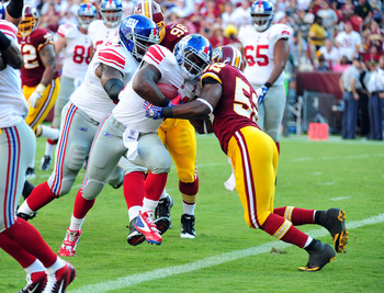 LANDOVER, MD - SEPTEMBER 11: Ahmad Bradshaw #44 of the New York Giants carries the ball to score against Rocky McIntosh #52 of the Washington Redskins season-opening game at FedEx Field on September 11, 2011 in Landover, Maryland. (Photo by Scott Cunningh