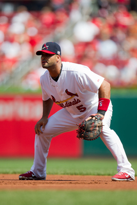 ST. LOUIS, MO - SEPTEMBER 11: Albert Pujols #5 of the St. Louis Cardinals watches the batter during the game at Busch Stadium on September 11, 2011 in St. Louis, Missouri. St. Louis defeated the Atlanta 6-3. (Photo by David Welker/Getty Images)