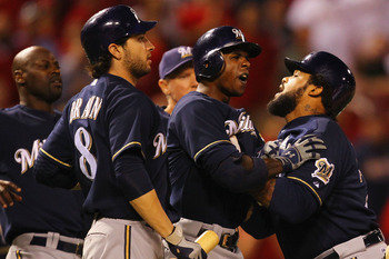 ST. LOUIS, MO -SEPTEMBER 7: Prince Fielder #28 and Ryan Braun #8 of the Milwaukee Brewers restrain Nyjer Morgan #2 of the Milwaukee Brewers after Morgan confronted starter Chris Carpenter #29 of the St. Louis Cardinals about a strike out at Busch Stadium
