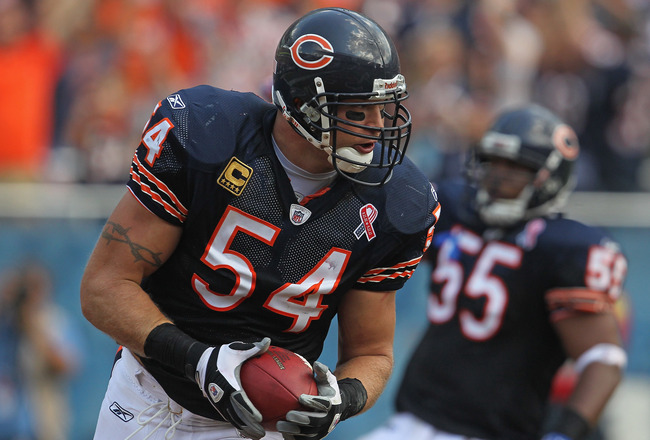 CHICAGO, IL - SEPTEMBER 11:  Brian Urlacher #54 of the Chicago Bears crosses the goal line for a touchdown after picking up a fumbled ball against the Atlanta Falcons at Soldier Field on September 11, 2011 in Chicago, Illinois. The Bears defeated the Falc