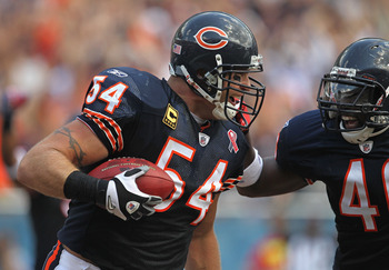 CHICAGO, IL - SEPTEMBER 11:  Brian Urlacher #54 and Chris Harris #46 of the Chicago Bears celebrate Urlacher's touchdown run against the Atlanta Falcons at Soldier Field on September 11, 2011 in Chicago, Illinois. The Bears defeated the Falcons 30-12.  (P
