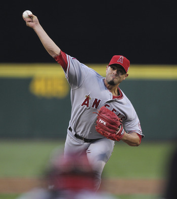 SEATTLE - AUGUST 29:  Starting pitcher Joel Pineiro #35 of the Los Angeles Angels of Anaheim pitches against the Seattle Mariners at Safeco Field on August 29, 2011 in Seattle, Washington. (Photo by Otto Greule Jr/Getty Images)