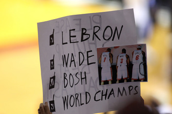 MIAMI, FL - JUNE 12:  Fans of the Miami Heat holds up a sign in support of LeBron James, Dwyane Wade and Chris Bosh in Game Six of the 2011 NBA Finals at American Airlines Arena on June 12, 2011 in Miami, Florida. NOTE TO USER: User expressly acknowledges
