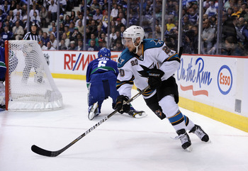 VANCOUVER, CANADA - MAY 24:  Kyle Wellwood #20 of the San Jose Sharks skates around the net in Game Five of the Western Conference Finals against the Vancouver Canucks during the 2011 Stanley Cup Playoffs at Rogers Arena on May 24, 2011 in Vancouver, Brit