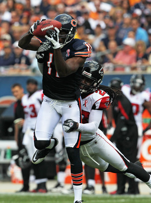 CHICAGO, IL - SEPTEMBER 11: Roy Williams #11 of the Chicago Bears catches a pass in front of Dunta Robinson #23 of the Atlanta Falcons at Soldier Field on September 11, 2011 in Chicago, Illinois. The Bears defeated the Falcons 30-12. (Photo by Jonathan Da