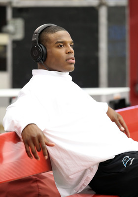 GLENDALE, AZ - SEPTEMBER 11:  Quarterback Cam Newton #1 of the Carolina Panthers sits on the bench prior to the NFL season opener game against the Arizona Cardinals at the University of Phoenix Stadium on September 11, 2011 in Glendale, Arizona.  (Photo b