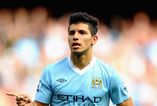 MANCHESTER, ENGLAND - SEPTEMBER 10: Sergio Aguero of Manchester City celebrates his second goal during the Barclays Premier League match between Manchester City and Wigan Athletic at Etihad Stadium on September 10, 2011 in Manchester, England.  (Photo by