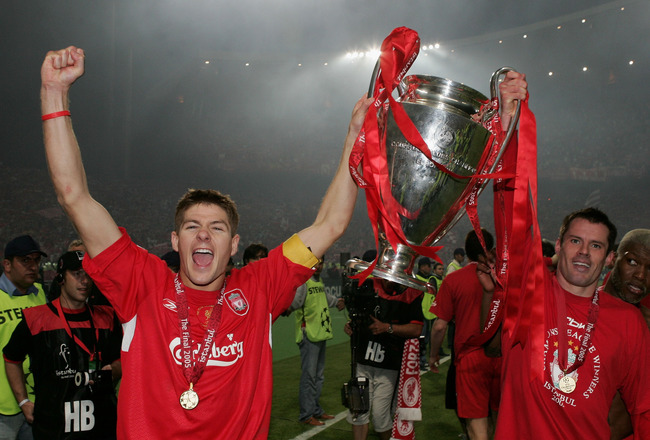 ISTANBUL, TURKEY - MAY 25:  Liverpool captain Steven Gerrard (L) and defender Jamie Carragher lift the European Cup after Liverpool won the European Champions League final against AC Milan on May 25, 2005 at the Ataturk Olympic Stadium in Istanbul, Turkey