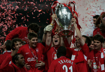 ISTANBUL, TURKEY - MAY 25:  Liverpool defender John Arne Riise of Norway lifts the European Cup after Liverpool won the European Champions League final between Liverpool and AC Milan on May 25, 2005 at the Ataturk Olympic Stadium in Istanbul, Turkey.  (Ph