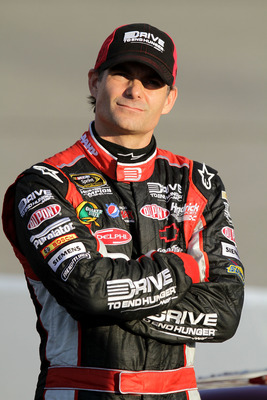 RICHMOND, VA - SEPTEMBER 09:  Jeff Gordon, driver of the #24 Drive to End Hunger Chevrolet, stands on the grid  during qualifying for the Sprint Cup Series Wonderful Pistachios 400 at Richmond International Raceway on September 9, 2011 in Richmond, Virgin