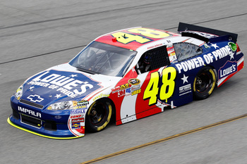 RICHMOND, VA - SEPTEMBER 09:  Jimmie Johnson, driver of the #48 Lowe's/Power of Pride Chevrolet, practices for the Sprint Cup Series Wonderful Pistachios 400 at Richmond International Raceway on September 9, 2011 in Richmond, Virginia.  (Photo by Todd War