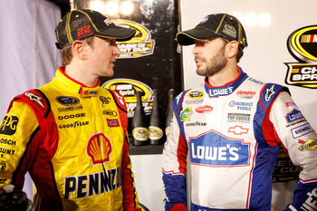 RICHMOND, VA - SEPTEMBER 10:  Jimmie Johnson, driver of the #48 Lowe's/Power of Pride Chevrolet, shakes hands with Kurt Busch, driver of the #22 Shell/Pennzoil Dodge, after the NASCAR Sprint Cup Series Wonderful Pistachios 400 at Richmond International Ra