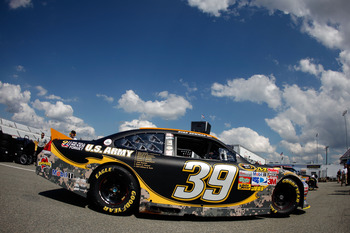 RICHMOND, VA - SEPTEMBER 09:  Ryan Newman, driver of the #39 U.S. Army-9/11 Chevrolet, drives in the gargae area during practice for the Sprint Cup Series Wonderful Pistachios 400 at Richmond International Raceway on September 9, 2011 in Richmond, Virgini