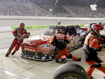 RICHMOND, VA - SEPTEMBER 10:  Tony Stewart, driver of the #14 Office Depot/Mobil 1 Chevrolet, makes a pit stop during the NASCAR Sprint Cup Series Wonderful Pistachios 400 at Richmond International Raceway on September 10, 2011 in Richmond, Virginia.  (Ph