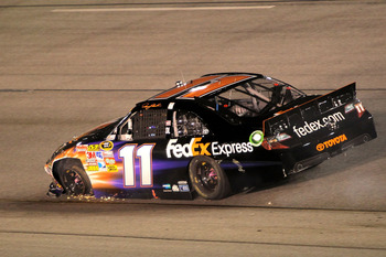 RICHMOND, VA - SEPTEMBER 10:  Denny Hamlin, driver of the #11 FedEx Express Toyota, drives after crashing during the NASCAR Sprint Cup Series Wonderful Pistachios 400 at Richmond International Raceway on September 10, 2011 in Richmond, Virginia.  (Photo b