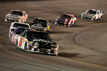 RICHMOND, VA - SEPTEMBER 10:  Dale Earnhardt Jr., driver of the #88 Amp Energy/National Guard Chevrolet, drives with damage to the front of his car during the NASCAR Sprint Cup Series Wonderful Pistachios 400 at Richmond International Raceway on September