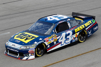 RICHMOND, VA - SEPTEMBER 09:  A.J. Allmendinger, driver of the #43 Best Buy Ford, practices for the Sprint Cup Series Wonderful Pistachios 400 at Richmond International Raceway on September 9, 2011 in Richmond, Virginia.  (Photo by Todd Warshaw/Getty Imag