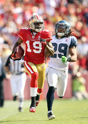 SAN FRANCISCO, CA - SEPTEMBER 11:  Ted Ginn #19 of the San Francisco 49ers outruns Earl Thomas #29 of the Seattle Seahawks on his way to scoring a touchdown on a kickoff return during their season opener at Candlestick Park on September 11, 2011 in San Fr