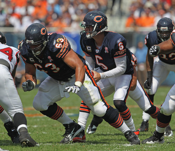 CHICAGO, IL - SEPTEMBER 11: Jay Cutler #6 of the Chicago Bears takes the snap from Roberto Garza #63 against the Atlanta Falcons at Soldier Field on September 11, 2011 in Chicago, Illinois. The Bears defeated the Falcons 30-12. (Photo by Jonathan Daniel/G