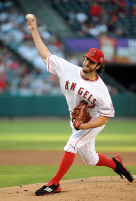 ANAHEIM, CA - SEPTEMBER 10:  Dan Haren #24 of the Los Angeles Angels of Anaheim pitches against the New York Yankees at Angel Stadium of Anaheim on September 10, 2011 in Anaheim, California.  (Photo by Lisa Blumenfeld/Getty Images)