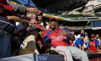 MILWAUKEE, WI - SEPTEMBER 10:  Jimmy Rollins #11 of the Philadelphia Phillies signs autographs for fans prior to their game against the Milwaukee Brewers at Miller Park on September 10, 2011 in Milwaukee, Wisconsin.(Photo by Mark Hirsch/Getty Images)