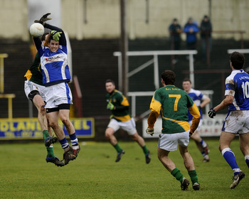 Players from Laois and Meath battle for possesion