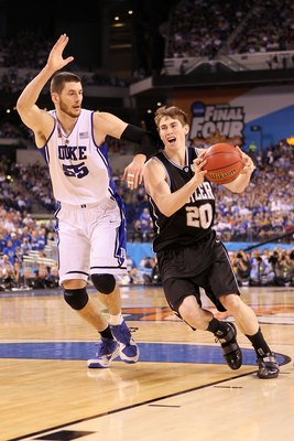 INDIANAPOLIS - APRIL 05:  Gordon Hayward #20 of the Butler Bulldogs drives against Brian Zoubek #55 of the Duke Blue Devils during the 2010 NCAA Division I Men's Basketball National Championship game at Lucas Oil Stadium on April 5, 2010 in Indianapolis,
