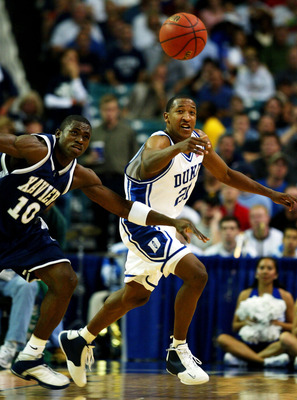 ATLANTA - MARCH 28:   Chris Duhon #21 of the Duke Blue Devils steals the ball from Romain Sato #10 of the Xavier Muskateers during the fourth round game of the NCAA Division I Men's Basketball Tournament at the Georgia Dome on March 28, 2004 in Atlanta, G