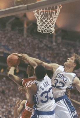 4 Apr 1992:  Alan Henderson of the Indiana Hoosiers tries to shoot the ball over center Christian Laettner and forward Grant Hill of the Duke Blue Devils during a playoff game at the Hubert H. Humphrey Metrodome in Minneapolis, Minnesota.  Duke won the ga