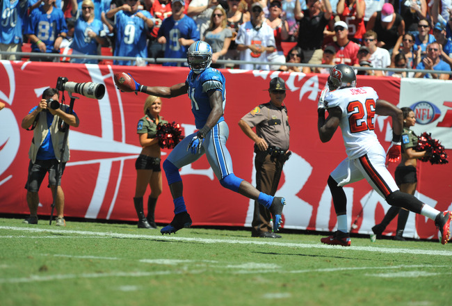 TAMPA, FL - SEPTEMBER 11:  Wide receiver Calvin Johnson #81 of the Detroit Lions scores a touchdown against the Tampa Bay Buccaneers during the season opener at Raymond James Stadium September 11, 2011 in Tampa, Florida. (Photo by Al Messerschmidt/Getty I