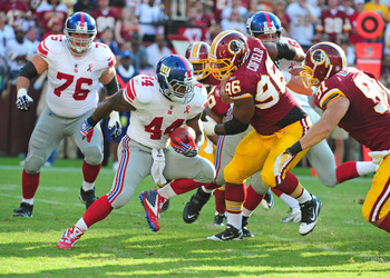 LANDOVER, MD - SEPTEMBER 11: Ahmad Bradshaw #44 of the New York Giants carries the ball against the Washington Redskins during the season-opening game at FedEx Field on September 11, 2011 in Landover, Maryland. (Photo by Scott Cunningham/Getty Images)