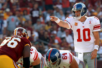 LANDOVER, MD - SEPTEMBER 11:  Quarterback Eli Manning #10 of the New York Giants calls out from under center against the Washington Redskins in the second quarter at FedExField on September 11, 2011 in Landover, Maryland.  (Photo by Ronald Martinez/Getty