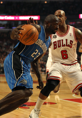 CHICAGO, IL - JANUARY 28: Jason Richardson #23 of the Orlando Magic moves against Keith Bogans #6 of the Chicago Bulls at the United Center on January 28, 2011 in Chicago, Illinois. The Bulls defeated the Magic 99-90. NOTE TO USER: User expressly acknowle