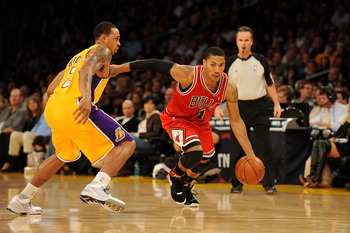 LOS ANGELES, CA - NOVEMBER 19:  Derrick Rose #1 of the Chicago Bulls drives against Shannon Brown #12 of the Los Angeles Lakers during the game on November 19, 2009 at Staples Center in Los Angeles, California.  The Lakers won 108-93.  NOTE TO USER: User