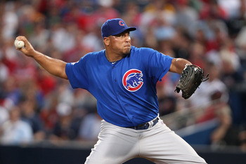 ATLANTA, GA - AUGUST 12:  Pitcher Carlos Zambrano #38 of the Chicago Cubs throws a pitch during the game against the Atlanta Braves at Turner Field on August 12, 2011 in Atlanta, Georgia.  (Photo by Mike Zarrilli/Getty Images)