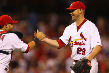 ST. LOUIS, MO -SEPTEMBER 7: Starter Chris Carpenter #29 and Yadier Molina #4 of the St. Louis Cardinals celebrate a victory over the Milwaukee Brewersat Busch Stadium on September 7, 2011 in St. Louis, Missouri.  The Cardinals beat the Brewers 2-0.  (Phot