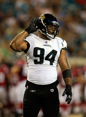 JACKSONVILLE, FL - AUGUST 19:  Jeremy Mincey #94 of the Jacksonville Jaguars asks for crowd noise during a game against the Atlanta Falcons at EverBank Field on August 19, 2011 in Jacksonville, Florida.  (Photo by Sam Greenwood/Getty Images)