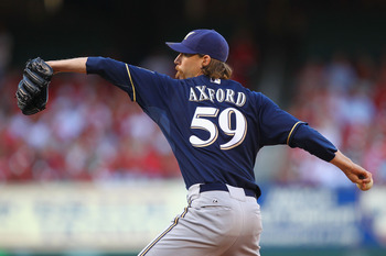 ST. LOUIS, MO -SEPTEMBER 5: Reliever John Axford #59 of the Milwaukee Brewers pitches against the St. Louis Cardinals at Busch Stadium on September 5, 2011 in St. Louis, Missouri.  The Brewers defeated the Cardinals 4-1.  (Photo by Dilip Vishwanat/Getty I