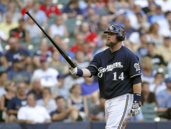 MILWAUKEE, WI - SEPTEMBER1:  Casey McGehee #14 of the Milwaukee Brewers flips his bat in the air after striking out in the 6th inning  during their game against the St Louis Cardinals at Miller Park on September 1, 2011 in Milwaukee, Wisconsin. The Cardin