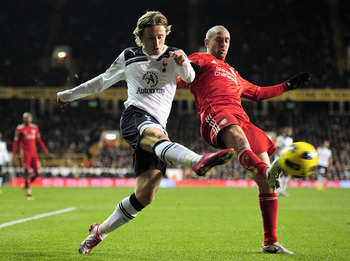 LONDON, ENGLAND - NOVEMBER 28:  Raul Meireles of Liverpool blocks a cross by Luka Modric of Tottenham Hotspur during the Barclays Premier League match between Tottenham Hotspur and Liverpool at White Hart Lane on November 28, 2010 in London, England.  (Ph
