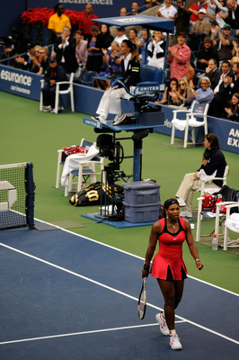 NEW YORK, NY - SEPTEMBER 11:  Serena Williams of the United States walks past chair umpire Eva Asderakia while playing against Samantha Stosur of Australia during the Women's Singles Final on Day Fourteen of the 2011 US Open at the USTA Billie Jean King N