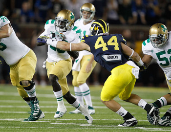 ANN ARBOR, MI - SEPTEMBER 10:  Cierre Wood #20 of the Notre Dame Fighting Irish tries to get around the tackle Desmond Morgan #44 of the Michigan Wolverines at Michigan Stadium on September 10, 2010 in Ann Arbor, Michigan. (Photo by Gregory Shamus/Getty I