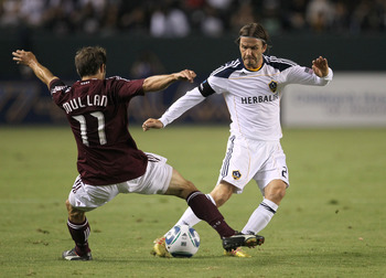 CARSON, CA - SEPTEMBER 9:  David Beckham #23 of the Los Angeles Galaxy passes the ball away from Brian Mullan #11 of the Colorado Rapids at The Home Depot Center on September 9, 2011 in Carson, California. The Galazy won 1-0.   (Photo by Stephen Dunn/Gett