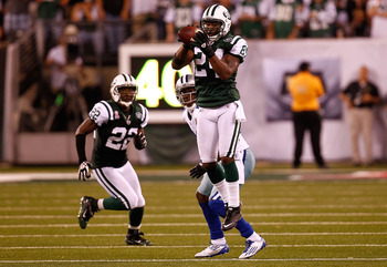 EAST RUTHERFORD, NJ - SEPTEMBER 11:  Darrelle Revis #24 of the New York Jets intercepts a pass in the fourth quarter against the Dallas Cowboys during their NFL Season Opening Game at MetLife Stadium on September 11, 2011 in East Rutherford, New Jersey.