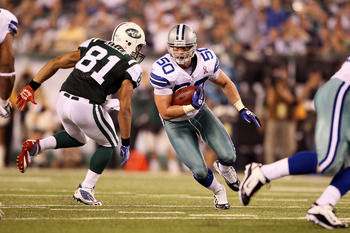 EAST RUTHERFORD, NJ - SEPTEMBER 11:  Sean Lee #50 of the Dallas Cowboys returns an interception of 37-yards in the fourth quarter against the New York Jets during their NFL Season Opening Game at MetLife Stadium on September 11, 2011 in East Rutherford, N