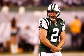 EAST RUTHERFORD, NJ - SEPTEMBER 11:  Nick Folk #2 of the New York Jets celebrates after he kicked a successful 50-yard game-winning field goal against the Dallas Cowboys during their NFL Season Opening Game at MetLife Stadium on September 11, 2011 in East